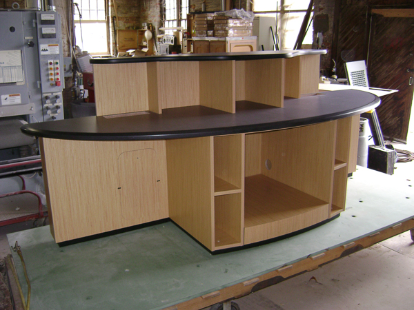 Custom desk with Wilsonart components and secret pull-out storage built into toekick